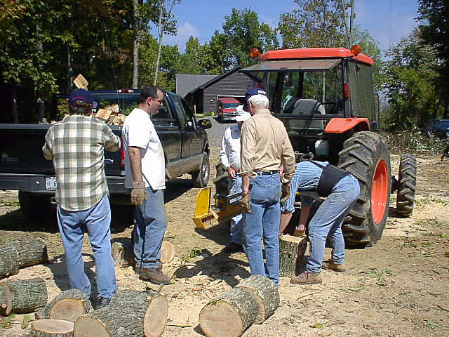 Project Crossroads volunteers cut firewood.